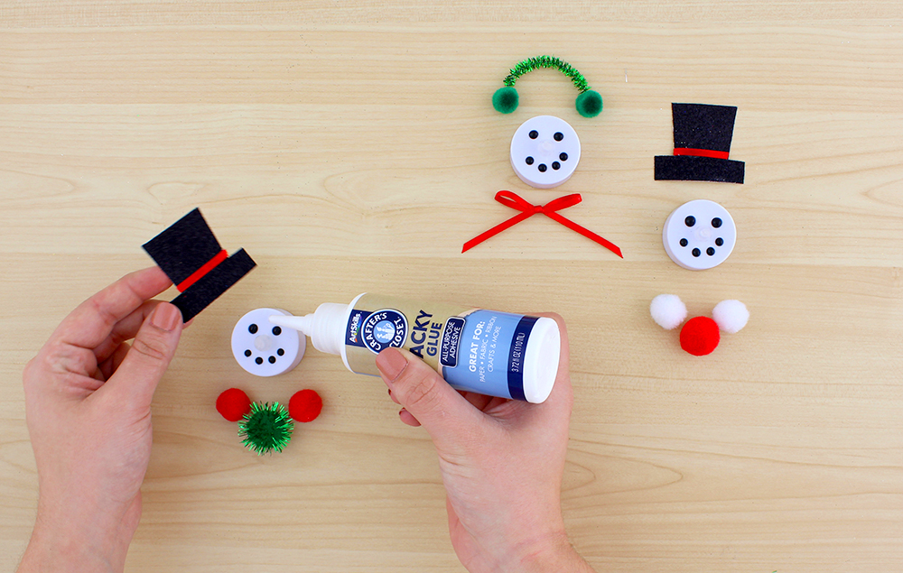 Use Tacky Glue To Attach The Top Hat. Or Attach Pom Poms, Pipe Cleaners And  A Ribbon To Make Cute Earmuffs.